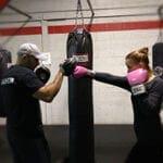 Woman and man boxing